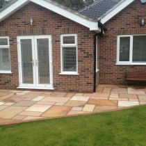 Natural stone patio with French doors