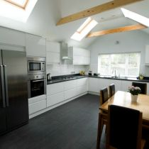 Kitchen with Velux windows and exposed roof ties